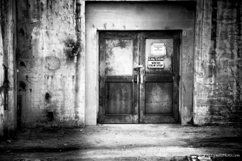 old metal crusty industrial doors at Reynolds Tobacco Bailey Power Plant. Winston Salem, NC. Black and white photograph